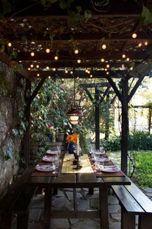 covered patio lights bench table garden pinterest
