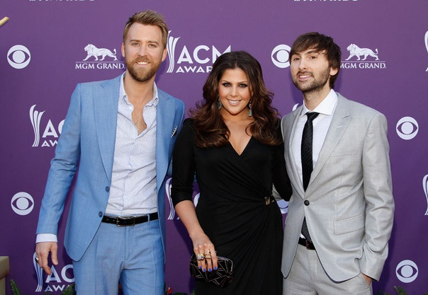 The members of Lady Antebellum, Charles Kelley, Hillary Scott and Dave Haywood, walk the red carpet at the 2012 Academy of Country Music Awards.  More Photos: http://bit.ly/Hey4wl  Photo Credit: AP Photo/Isaac Brekken