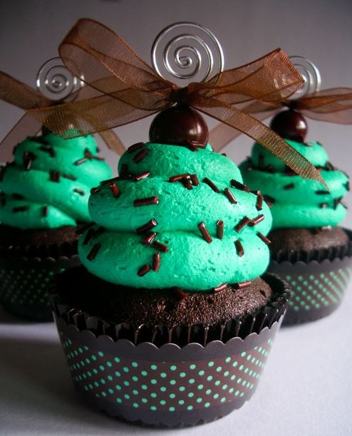 Dark chocolate cupcake with mint frosting, topped with chocolate ...