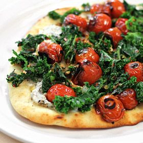 Flat Bread Pizza with Goat Cheese, Sauteed Greens and Cherry Tomatoes.