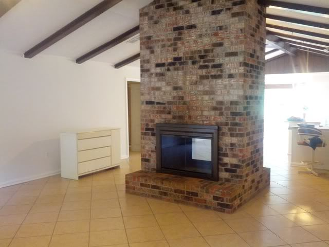 fireplace in middle of room craftsman interior