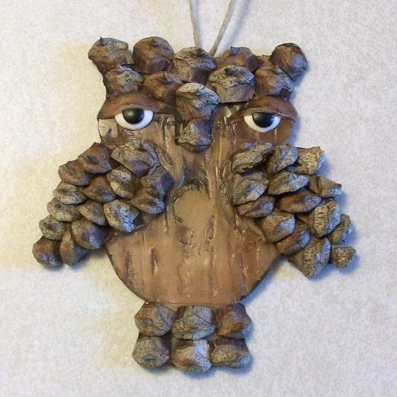 Wood look owl ornament with pine cone feathers