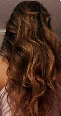 Medium ash brown hair with caramel highlights