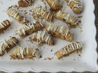 cranberry pecan biscotti with white chocolate drizzle