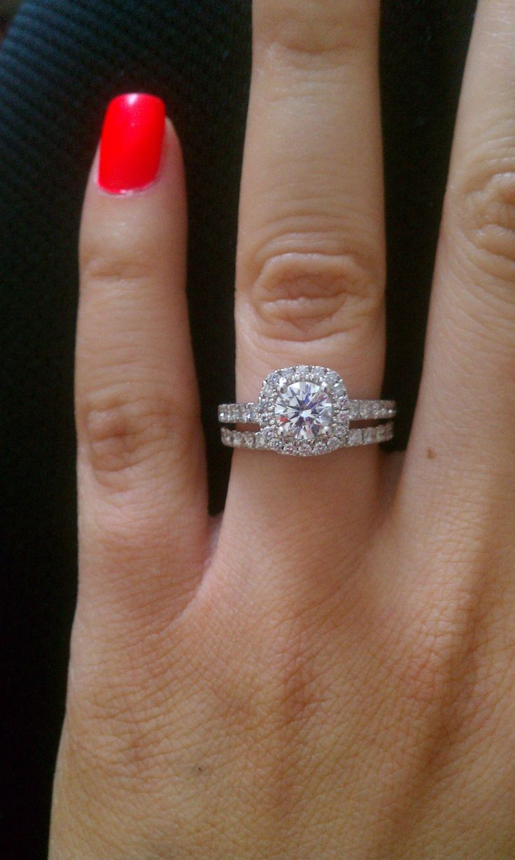 Classic round diamond set in a cushion halo engagement ring with pave ...