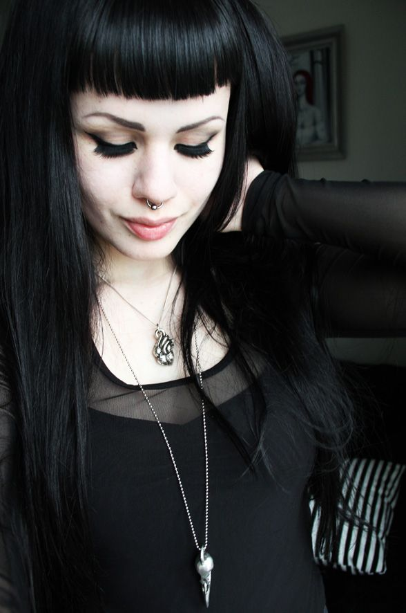 Dark eye make-up, morbid jewellery, simple black clothes <3