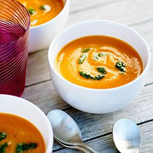 Velvety Carrot Soup with Carrot Top Pesto Recipe. Very yummy and easy.  I added some ginger for an extra zing.  I love that it uses all parts of the carrots!!