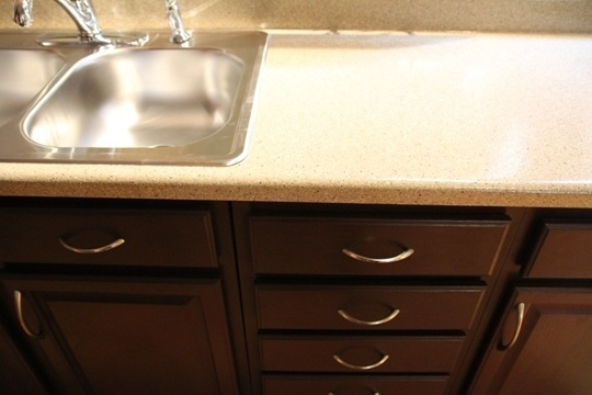 paint over ugly laminate countertops and gives you the look of granite