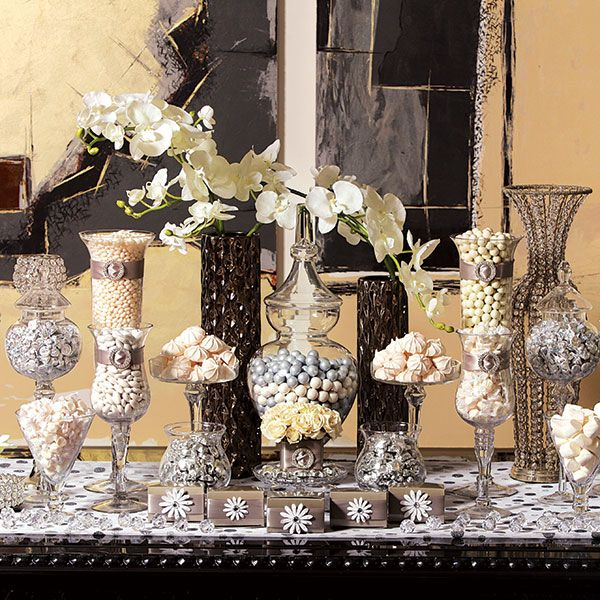 Gold candy buffet, Be it a vintage farmhouse table, a baker's rack or a sleek credenza, creative presentation is key to a dazzling candy experience. Vessels in various shapes and heights are also key to both overall design and ease of serving. this contemporary look in silver, black and white is perfect for a sophisticated cocktail party, engagement celebration or retro-glam reception.