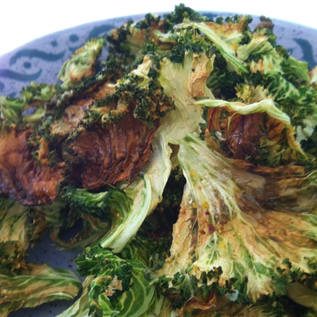 Crispy Kale chips with olive oil and natural sea salt infused with ...