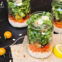Chopped italian salad with creamy caesar dressing in jars