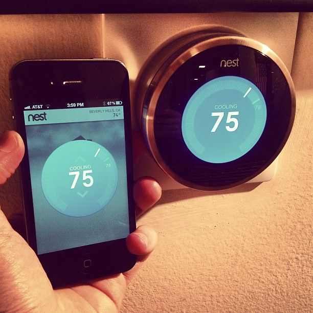 """Adjust home temperature via iphone with """"The Nest"""" thermostat."""