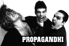 "Propagandhi.  Propagandhi's 1993 album How To Clean Everything features a song titled ""Head? Chest? or Foot?"", stating ""I'd rather be in prison in a George Orwellian world, than your pacified society of happy boys and girls."" in the final verse. The band also contributed a song titled ""War is Peace, Slavery is Freedom, May All Your Interventions Be Humanitarian"" to the Fat Wreck Chords compilation Live Fat, Die Young."