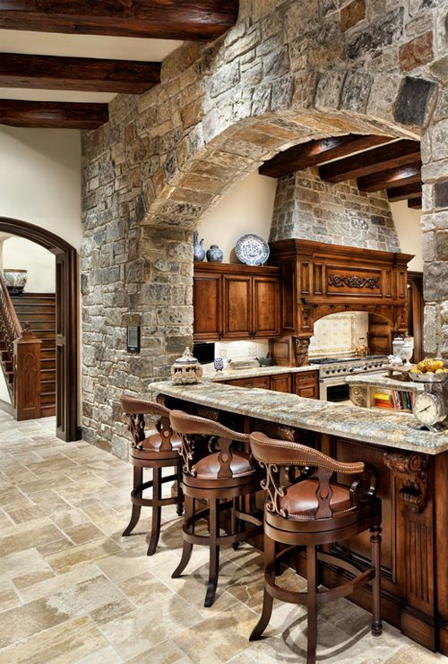 stone kitchen, wood, and gorgeous bar stools.