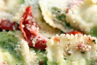basil & goat cheese ravioli with oven roasted tomatoes and parmesan