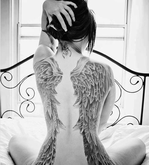 Large angel wings tattoo. If I ever go big and on my back Ill get ...