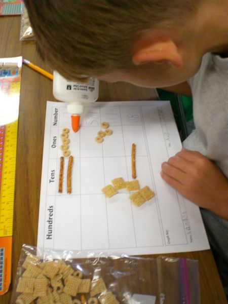 Fun place value. Pretzels and cheerios. could use chex squares for hundreds. FUN!