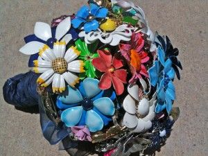 DIY flower brooch bouquet from Offbeat Bride. Meant for a wedding bouquet, but this would look super cute in the home.
