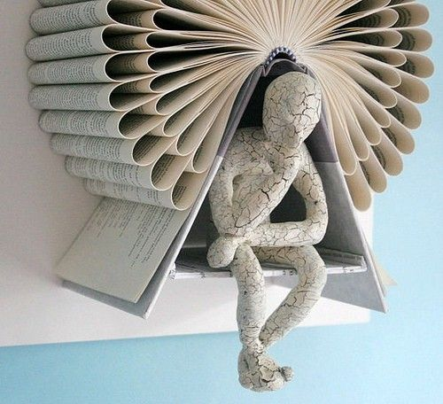 The Thinker made of books.
