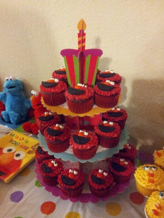 Elmo cupcakes... red velvet cake mix, red frosting, white sixlet eyes ...