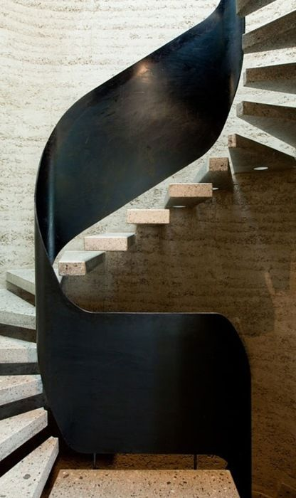 floating stairs and sinuous banister