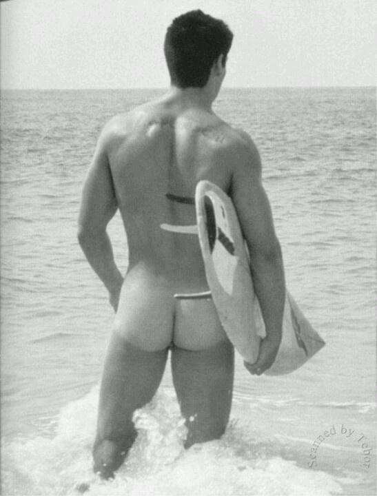 Surfer boy shows ass