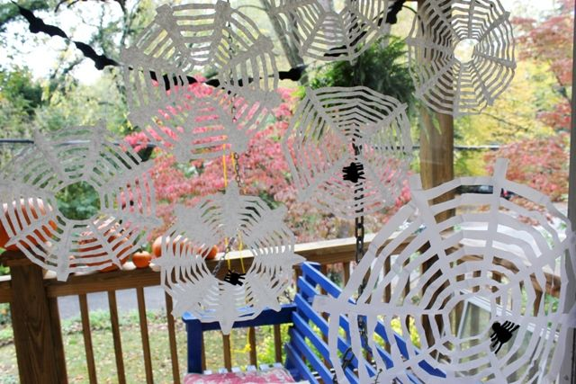 Coffee filter spider webs. Just like snowflakes...but creepier!