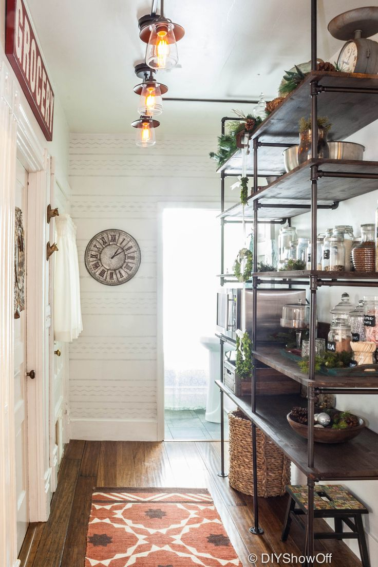 Industrial shelves in the pantry made of dark wood and pipes | Friday Favorites at www.andersonandgrant.com