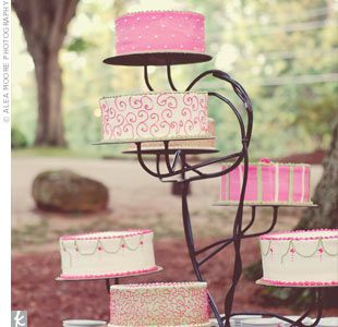 "An Outdoor Wedding in Statham, GA    ""We love cake,"" says the bride. The couple served several different cakes decorated in pink-and-green swirls, stripes, and dots. #Wedding #Cake"