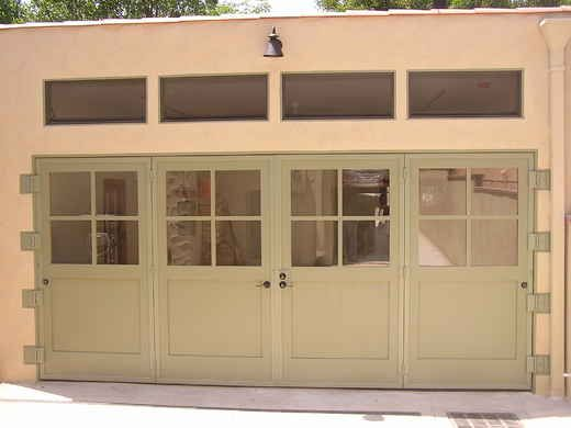 carriage doors to replace current roll up garage door