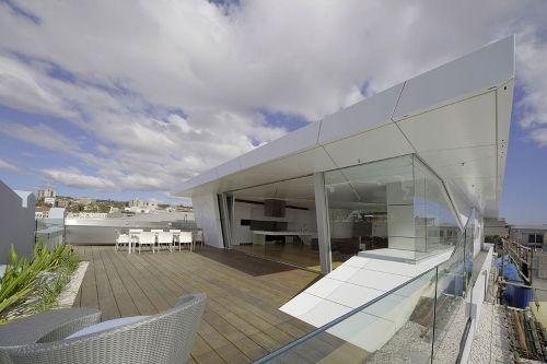 Situated on Sydney, Australia's famous beach for surfing, the Bondi Penthouse – designed by Brian Meyerson Architects – is a haven for luxury and minimalism.