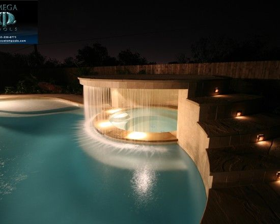 Waterfall around hot tub.
