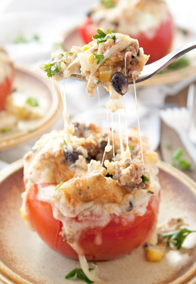 Flavorful quinoa, black beans and spicy sausage stuffed in ripe ...