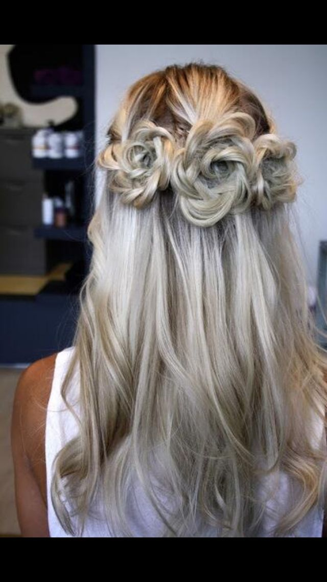 unique twist to the half up half down style. --flower girl