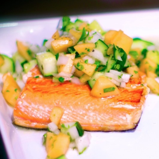 Pan-seared salmon with a cantaloupe cucumber salsa.