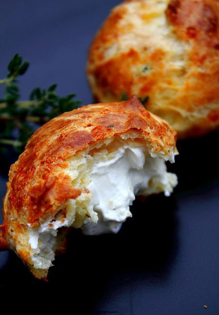 Cheddar-Thyme Gougères with creamy goat cheese filling.