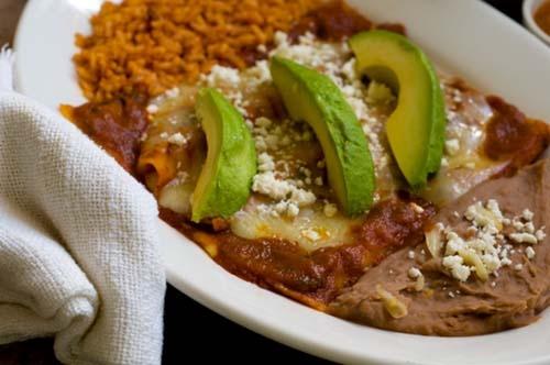 Entomatadas - enchiladas covered with a savory roasted tomato sauce.