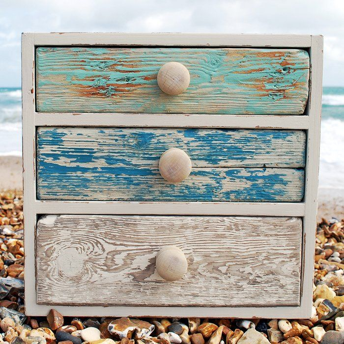 """Dulux Designer Elaine Cater recommends: """"The sea is a great interior design supplier. We are surrounded by the sea; why not use our locally found materials to create a unique piece of furniture. Driftwood drawers with a scrubbed effect wash of colour, a wonderful light distressed appearance of fresh colour. The Dulux Made by Me and Authentic Origins colour ranges are ideal for this type of look."""""""