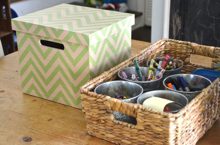 crayon storage and homework caddy... like how the cans are in a basket instead of upcycled box