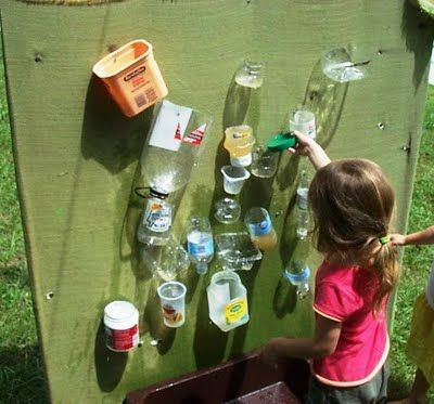 water wall: an outdoor contraption for water play designed so that children direct water in various streams, drips, and flows when it is poured over the top