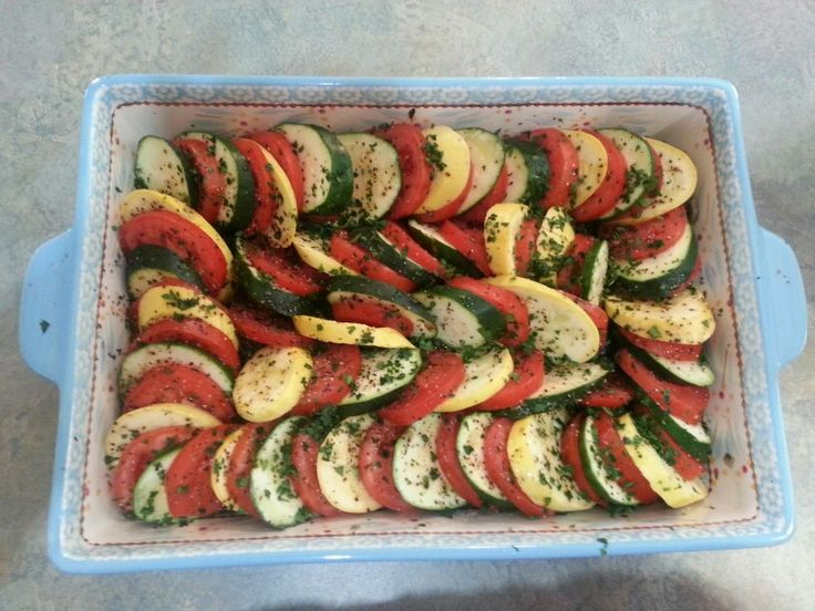with zucchini, squash, tomatoes on a bed of spinach which was sauted ...