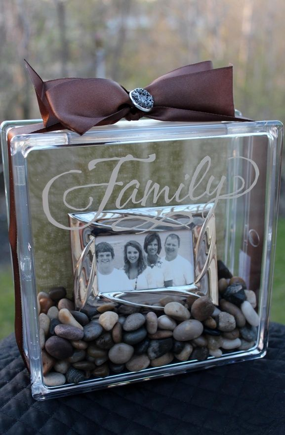 clear glass block with family pic inside. Get the blocks that open at Micheals.