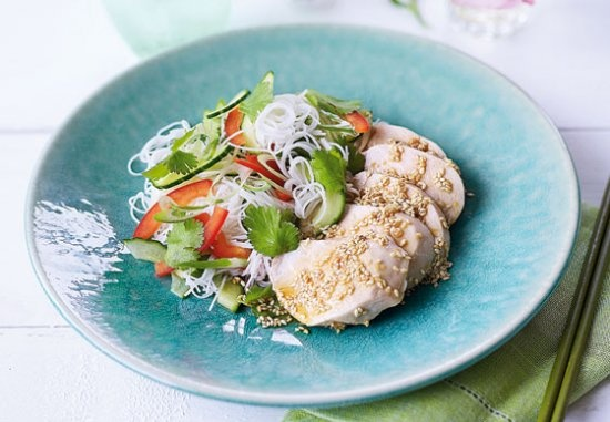 Poached chicken on vermicelli noodles with Asian vegetable salad and ...