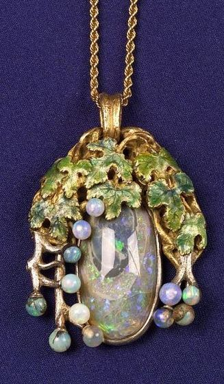 Black Opal, Opaline and Enamel Pendant, Tiffany & Co., c. 1905,the black opal among opaline grapes, vines and enamel leaves, 18kt gold and platinum mount, signed.