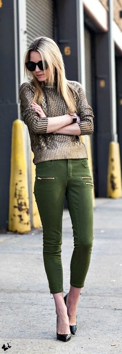 Green pants and sweater with high heel shoes