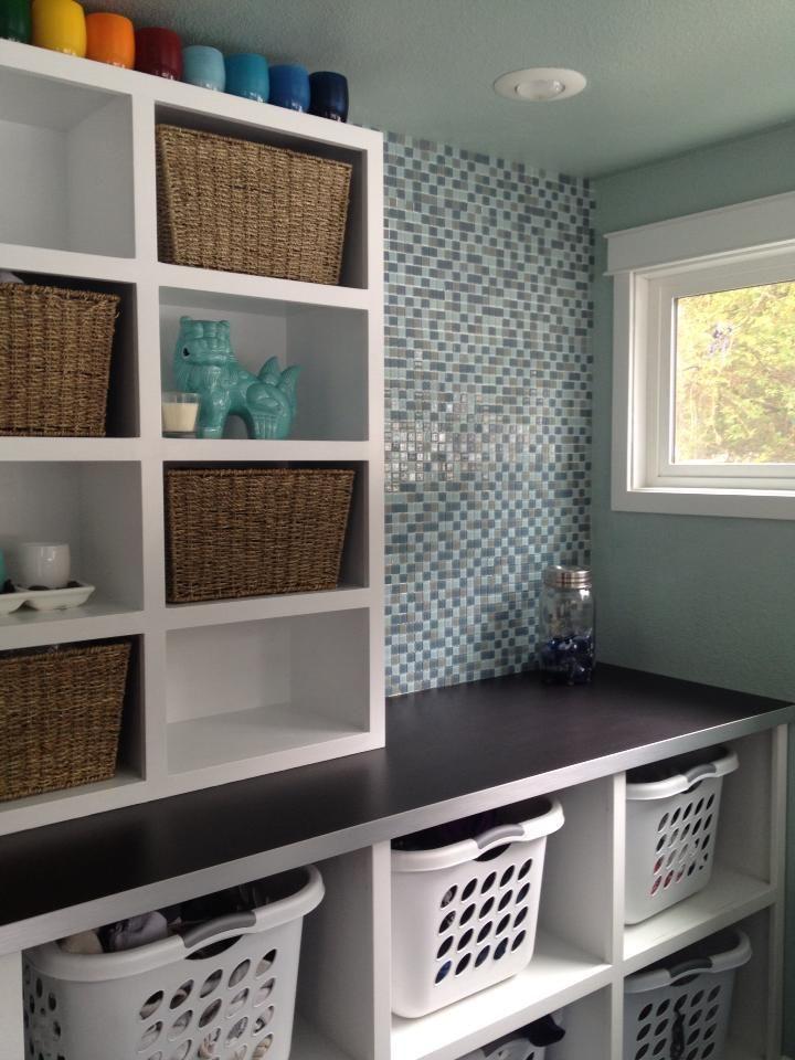 Laundry baskets and open shelves basement laundry rooms for Open shelving laundry room