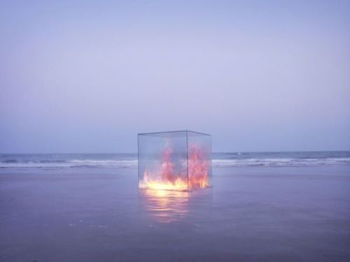 beauty = fire on the beach at sunset in a glass cube.