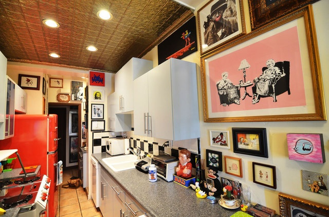 artsy kitchen with cherry red fridge great retro