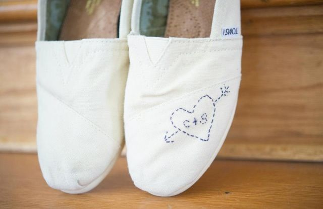 DIY wedding toms with initials  I just hand sewed our initials and the heart into a pair of cream toms I already had. They were PERFECT for the reception!