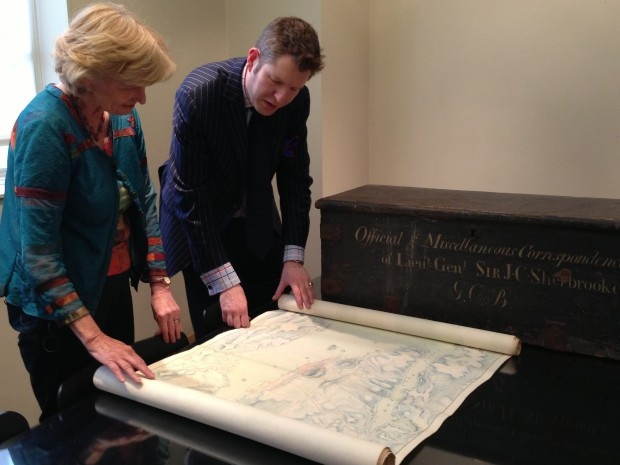 Ann Macmillan, chief of CBC's London bureau, is shown a large collection of letters and maps owned by Sir John Sherbrooke, the lieutenant-governor of Nova Scotia during the War of 1812. The items were auctioned in one block Wednesday for almost $700,000. (Ellen Mauro/CBC)